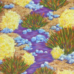 Sage, yucca, rocks and bright purple stream bed