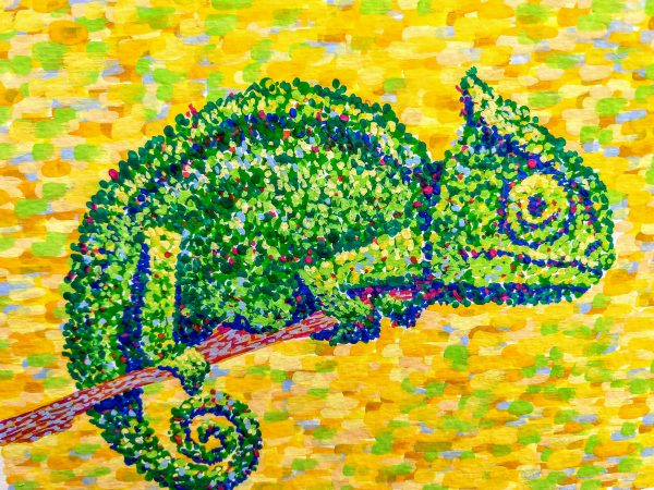 Brightly painted green chameleon in dots on bright yellow patterned background
